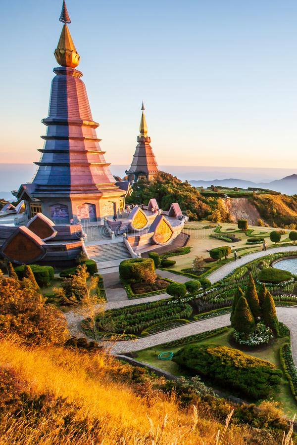 Sunset scenery landscape of two pagodas with tropical garden, tourists relaxing around two pagodas, beautiful mountain view. Doi. Sunset scenery landscape of two royalty free stock photos