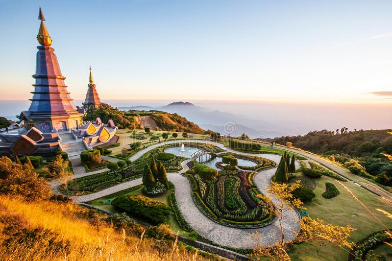 Sunset scenery landscape of two pagodas with tropical garden, tourists relaxing around two pagodas, beautiful mountain view. Doi. Sunset scenery landscape of two royalty free stock photo