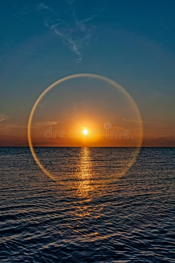 Sunset at sea with a circle effect.  royalty free stock photos