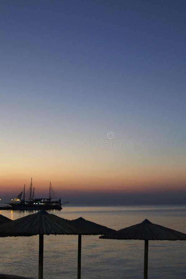 Sunset On The Sea With Docked Ship stock photo