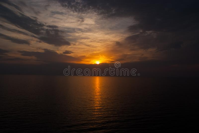 Sunset in sea on dramatic sky with clouds. transience of life. Seascape in evening dusk. Next day will be better stock photos