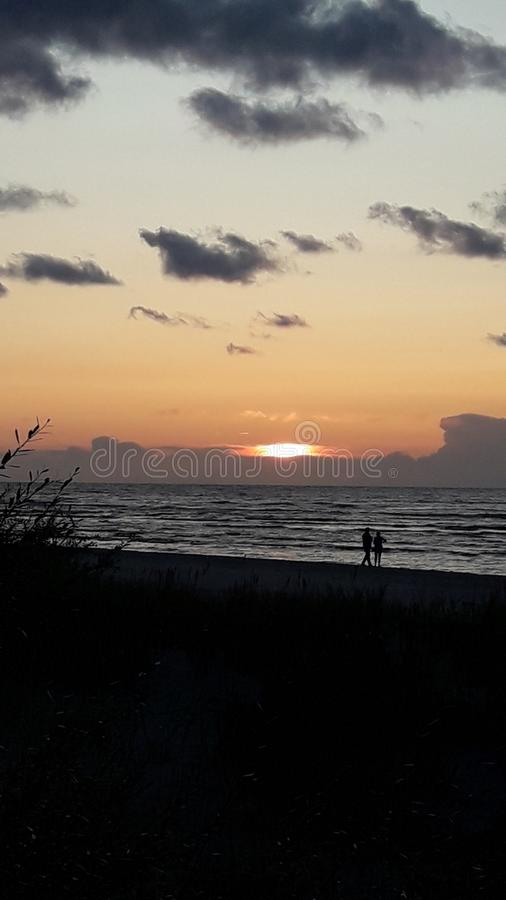 Sunset in sea royalty free stock photography