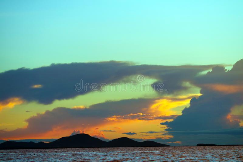 Sunset on sea flame cloud cold collide on sky. Silhouette islands royalty free stock photos