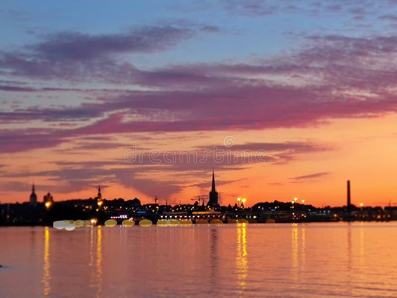 Sunset  on sea horizon tallinn panorama old town estonia baltic sea bokeh evening light effekt blurring reflection on water. City sunset  on sea horizon tallinn royalty free stock image