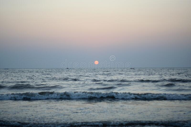 Sunset in Sea at juhu beach in Mumbai India royalty free stock images