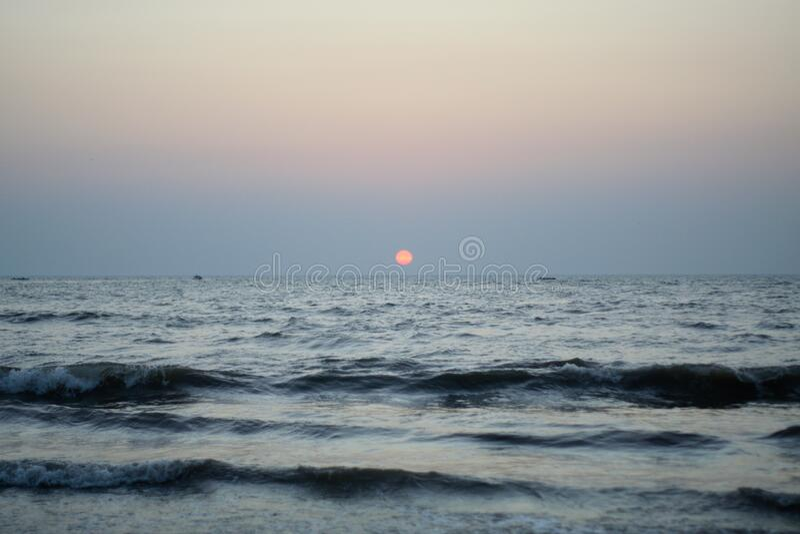 Sunset in Sea at juhu beach in Mumbai India stock images
