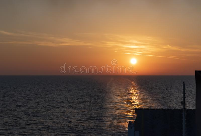 Sunset in the sea, Merchant Ship sailing in Adriatic Sea from Ancona port to Durres port Albania stock images