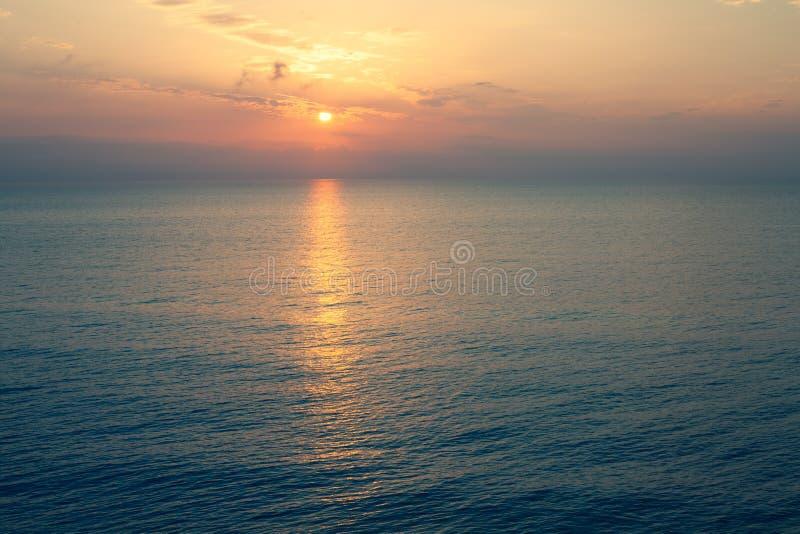 Sunset Sea over the Horizont. Beautiful Ocean Sunshine Landscape, Shimmering Twilight with yellow colors, Warm marine dusk Sun, Re stock photos