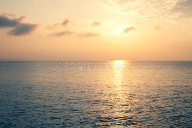 Sunset Sea over the Horizont. Beautiful Ocean Sunshine Landscape, Shimmering Twilight with yellow colors, Warm marine dusk Sun, Re royalty free stock photography