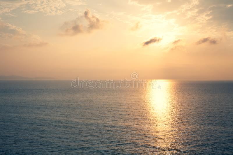 Sunset Sea over the Horizont. Beautiful Ocean Sunshine Landscape, Shimmering Twilight with yellow colors, Warm marine dusk Sun, Re royalty free stock images