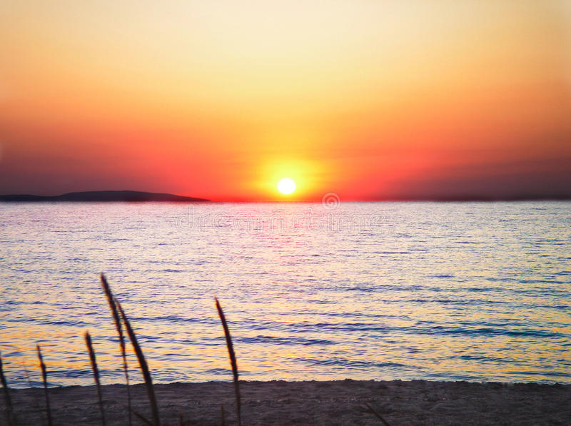 Sunset by the sea stock photos