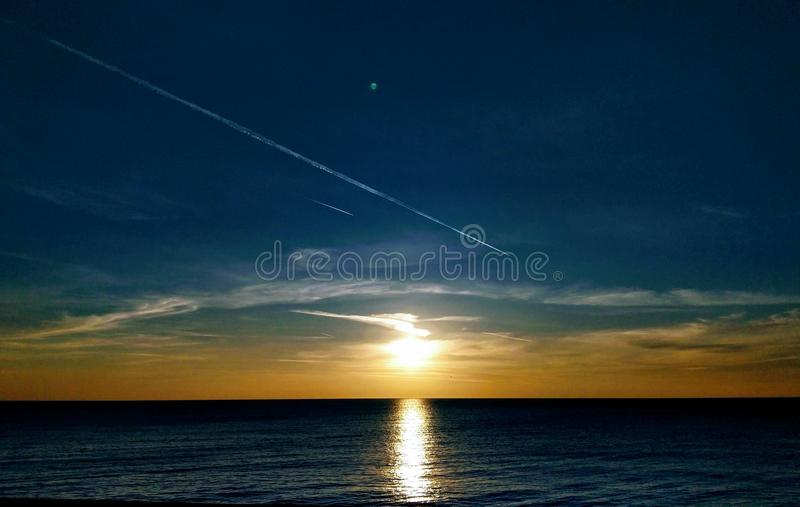 Sunset and sea reflection stock images