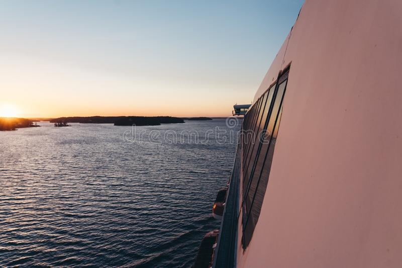 Sunset at sea seen from the side of a large ship in the Stockholm archipelago, Sweden. Sunset seen from the side of a large ship in the Stockholm archipelago royalty free stock images