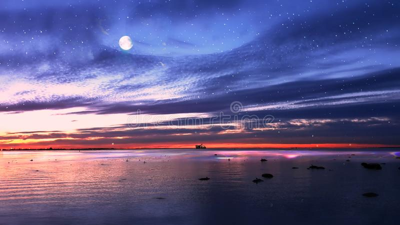 Sunset at sea sun light sky line evening light reflection on sea water gold summer sunset city panorama on horizon  Old town Talli. Tallinn old town night moon stock photos