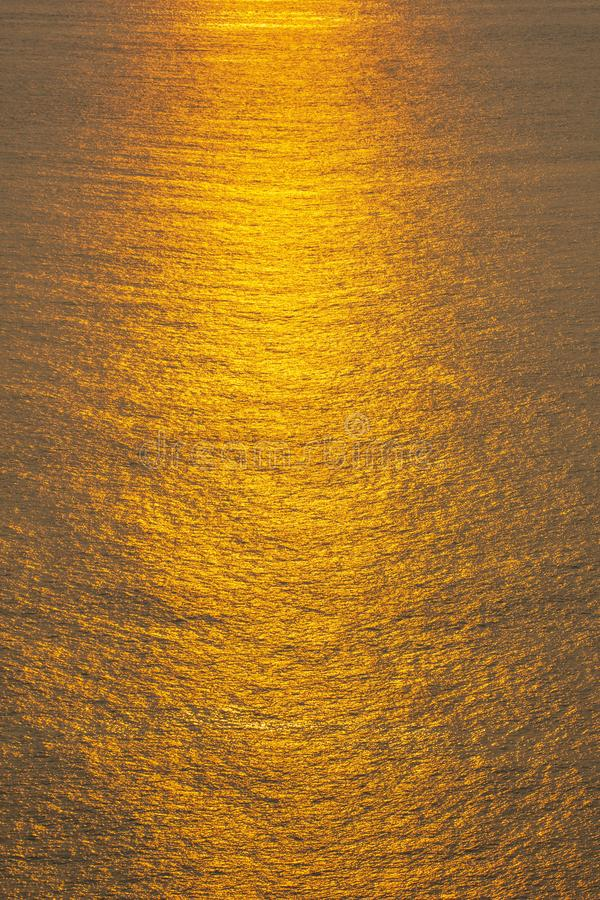 Sunset The sea surface reflects the sunlight in gold. Water serface royalty free stock photos