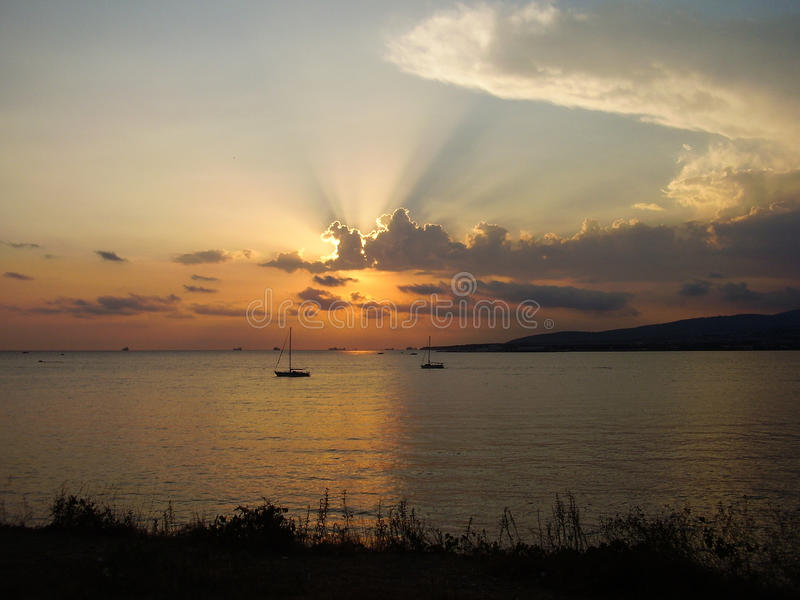 Sunset at sea. Sea sunset with two boats royalty free stock photo