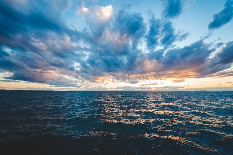 Sunset sea view with dramatic sky and colorful clouds royalty free stock photos
