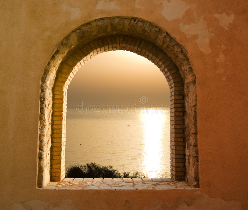 Sunset on the sea through the windows. Golden sunset on the sea through the windows royalty free stock photography