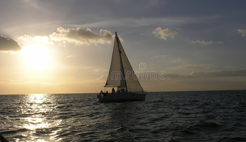 Sunset at sea and yacht stock photography