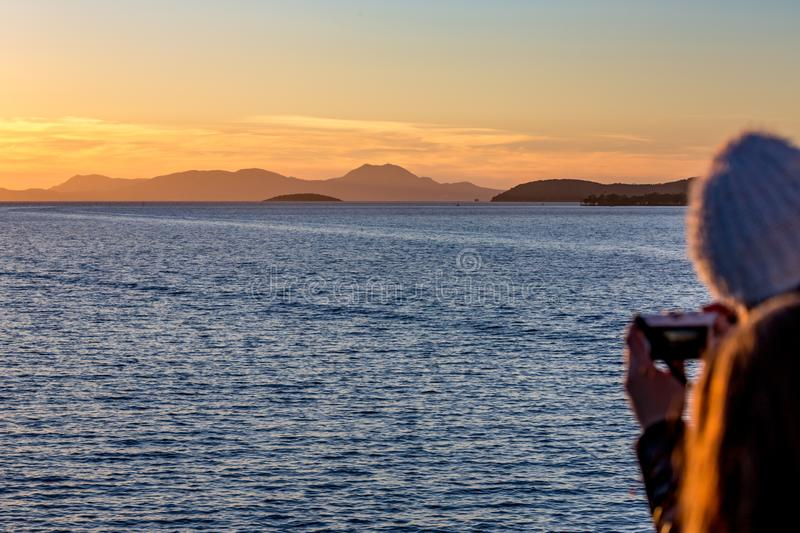 Sunset seascape Ionian Sea blurred girl in front stock photography