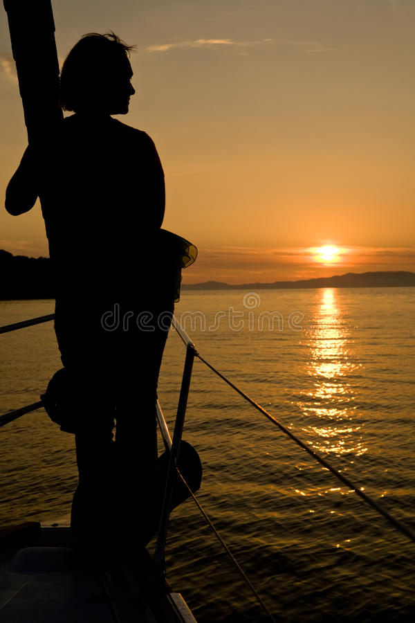 Sunset seascape with woman silhouette royalty free stock images