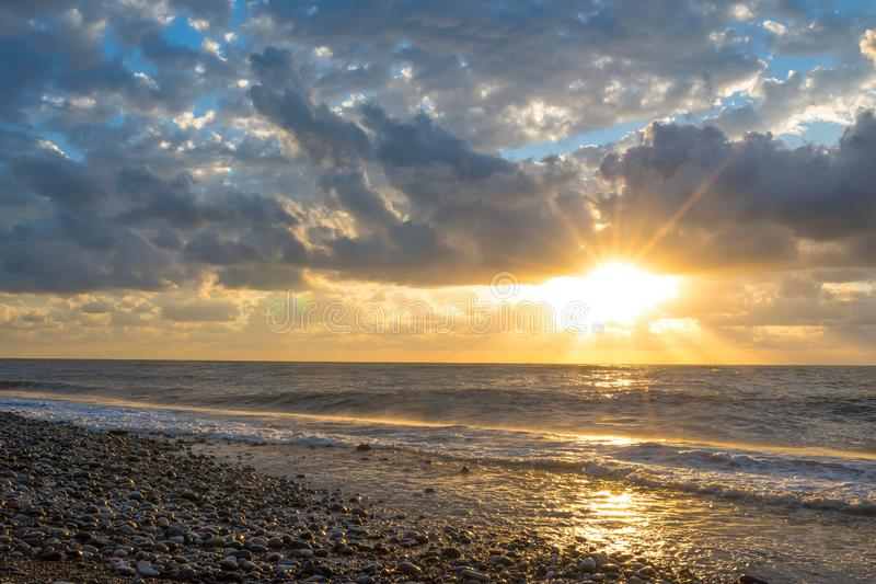 A sunset on the seashore. Clouds and skies. A sunset on the seashore. Sea and ocean. Clouds and skies stock photography