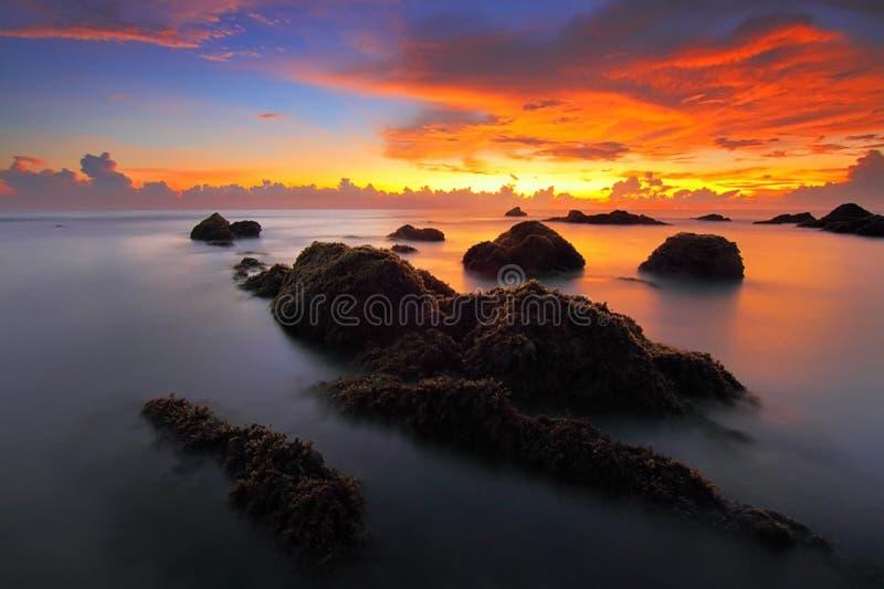 Sunset at seashore stock photos