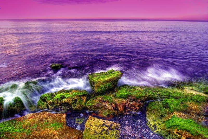 Sunset at seaside royalty free stock photos