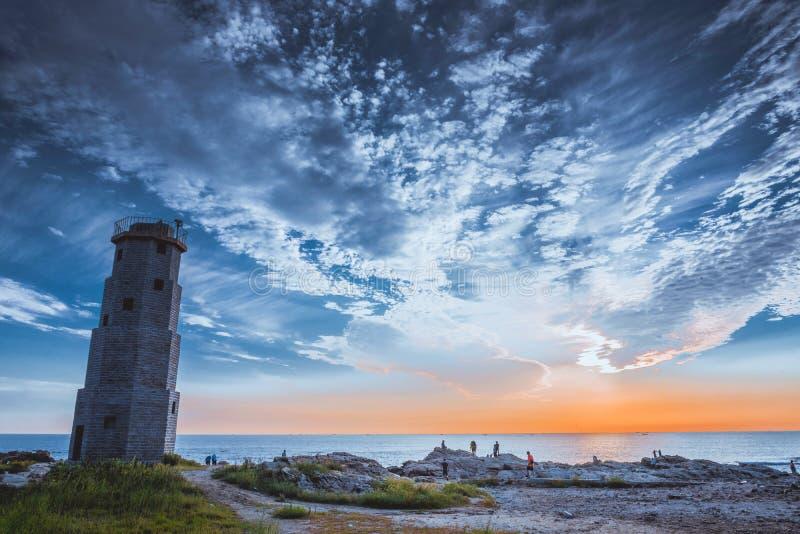 Sunset, seaside, blue sky, dusk, lighthouse, scenery, royalty free stock images