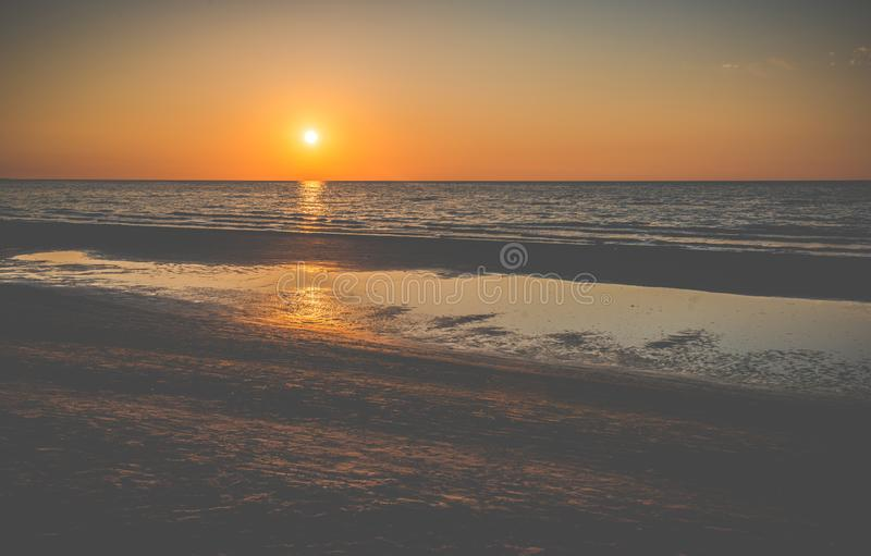 Sunset at the seaside stock images