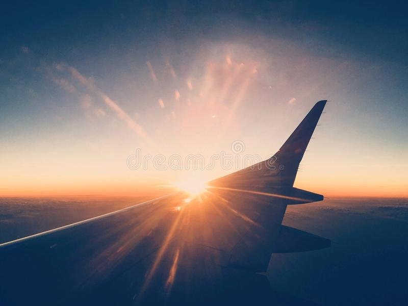 Sunset seen window plane royalty free stock photos