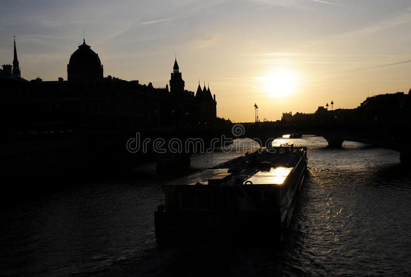 Sunset of seine river with ship stock photos