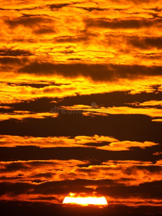 Sunset Shining Golden Light behind The Fluffy Clouds stock photos