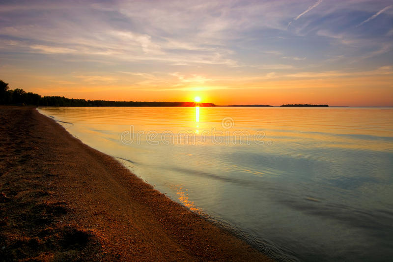 Sunset on the shore of a Minnesotan lake. stock images