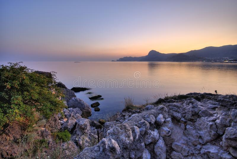 Sunset on the shore. royalty free stock images