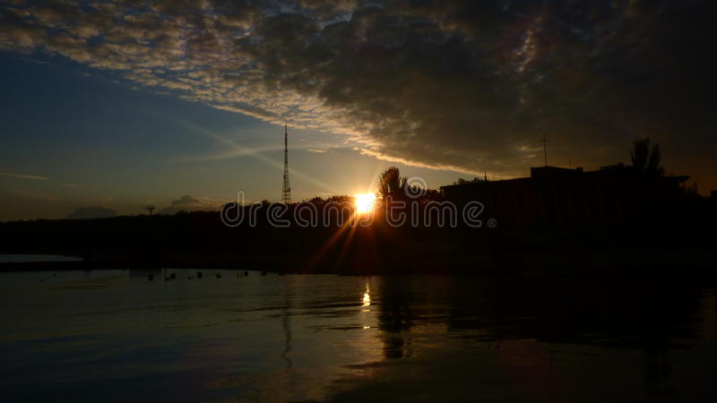 Sunset on the shore of the sea of Azov stock photos