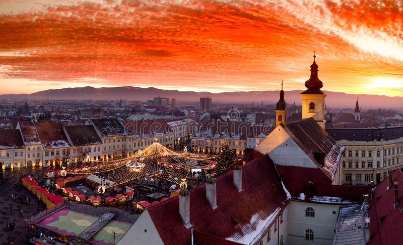 Sunset in Sibiu Transylvania, Romania, with Christmas Market visible. Sibiu Christmas Market at sunset in Transylvania, Romania, 2016. HDR Photography royalty free stock photos