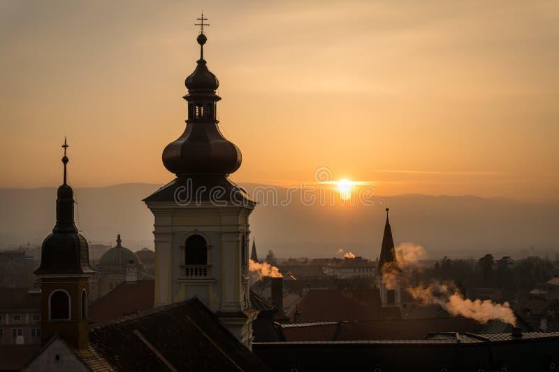 Sunset in Sibiu. Sunset view of Sibiu city with smoking chimney, Romania