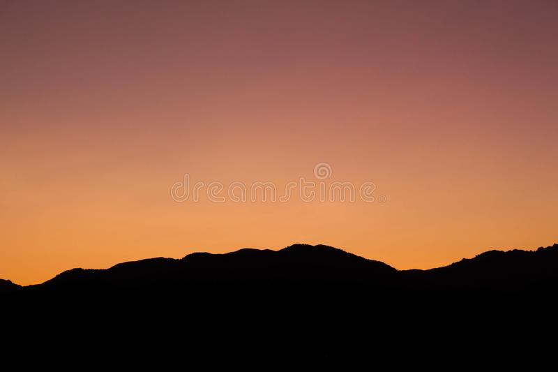 Sunset Silhouette of Mountains stock images