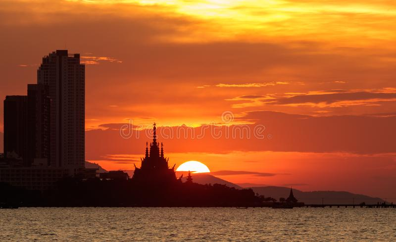 Sunset Silhouette Old and new buildings under the orange sky. The difference of modern era architecture with background the sunset with orange sky royalty free stock photos