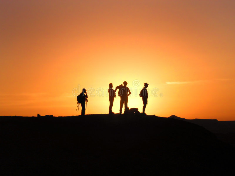 Sunset silhouettes stock image