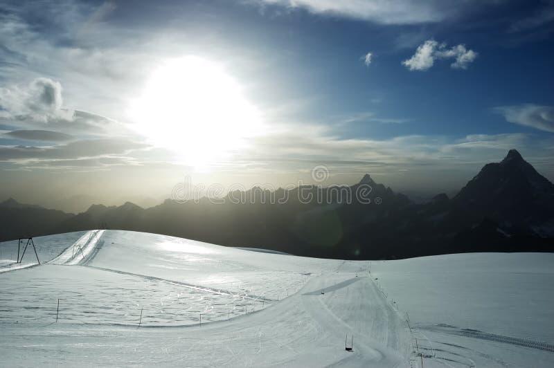 Sunset ski slope stock photos