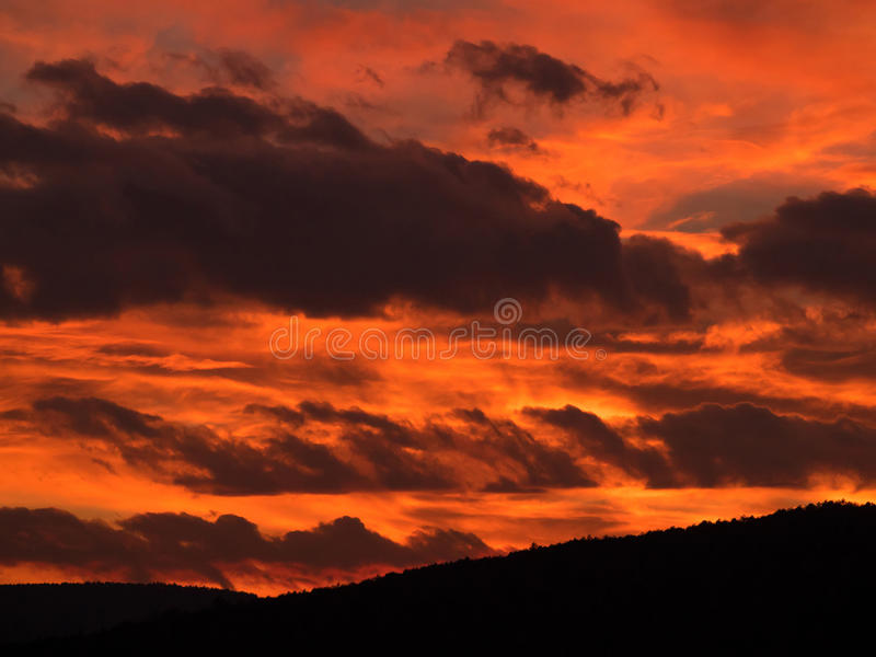 Red fiery sky fire dramatic clouds cloud orange flame background explosion black storm burning sunset winter mountains sunrise royalty free stock photos