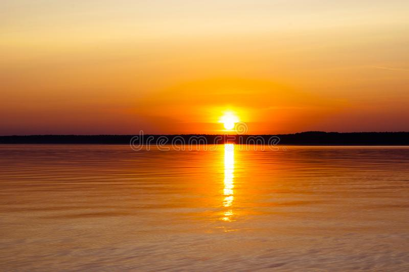 Water surface. View of a Sunset sky background. Dramatic gold sunset sky with evening sky clouds over the sea. View of a Crystal c royalty free stock images