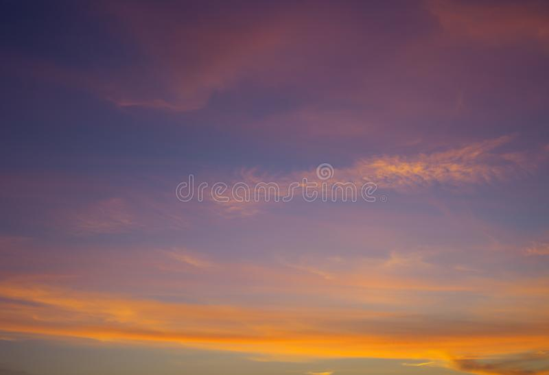 Sunset sky with bright orange clouds, abstract background. Sky Colorful clouds and sky royalty free stock image