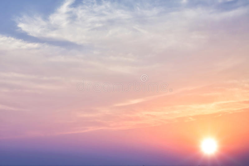 Sunset sky with bright sun. Beautiful sunset sky with bright sun and clouds stock photos