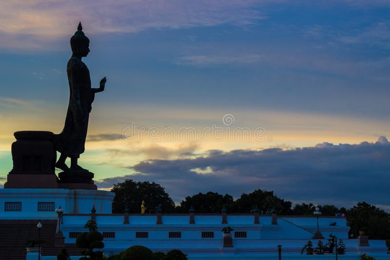 Sunset sky and Buddha statue at  Phutthamonthon,a Buddhist park in Nakhon Pathom Province of Thailand. BuddhamonthonPhutthamonthon is an important religious royalty free stock image