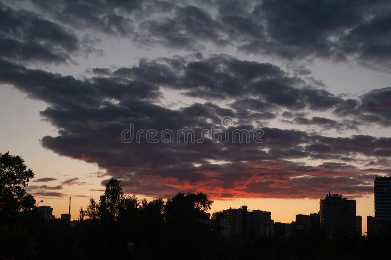 Sunset sky in the city. Sunset in the city. Silhouette photo of houses in the city at sunset. High quality photo stock images