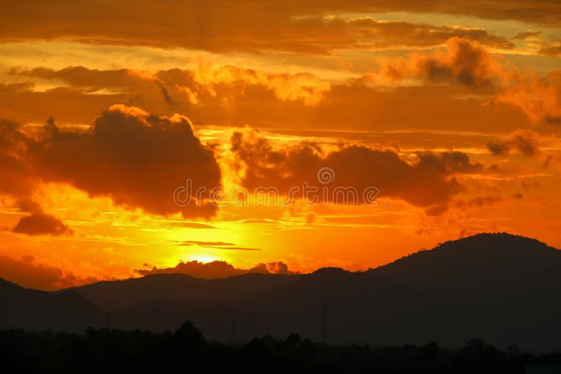 Sunset in sky and cloud, beautiful colorful twilight time with mountain silhouette stock photos