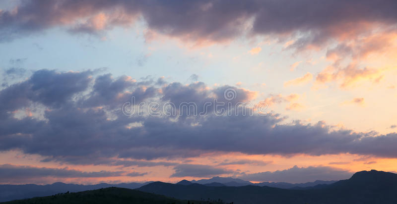 Sunset. Sky clouds background. Ridge Mountains silhouette. Skyline. Montenegro stock photo